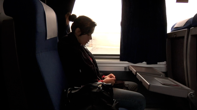 Sislhouetted Young Woman in Train Window